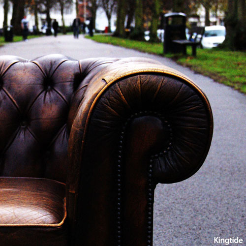 Kingtide album cover - a brown leather sofa placed in a street in Leamington